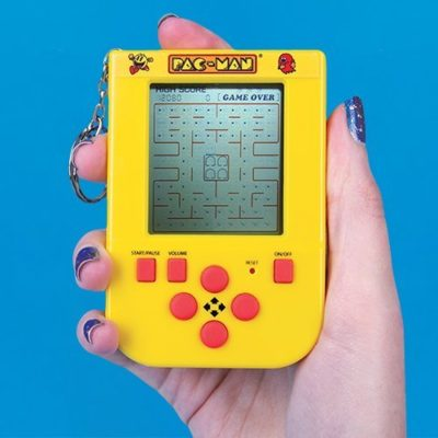PAC-MAN keyring game in a hand