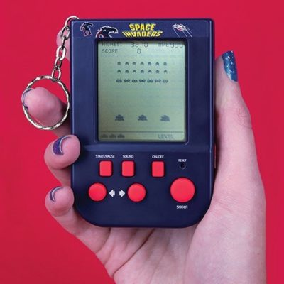 Space Invaders Keyring game held in a hand